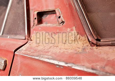 Layer Of Putty On Old Car
