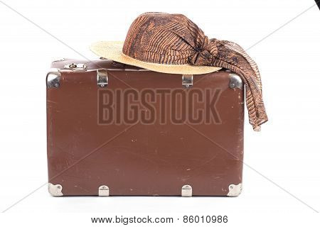 Vintage Suitcase With Straw Hat