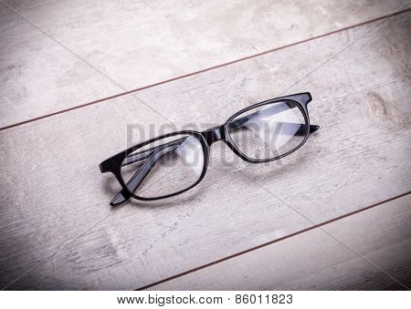 black glasses on wood  background