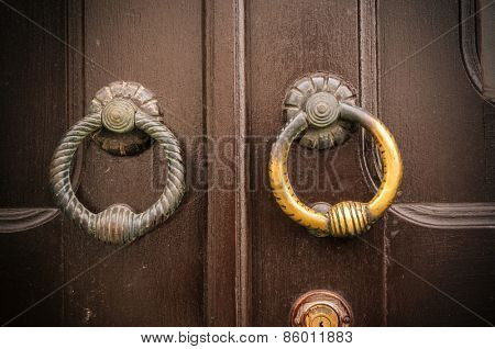 an old metal door handle knocker