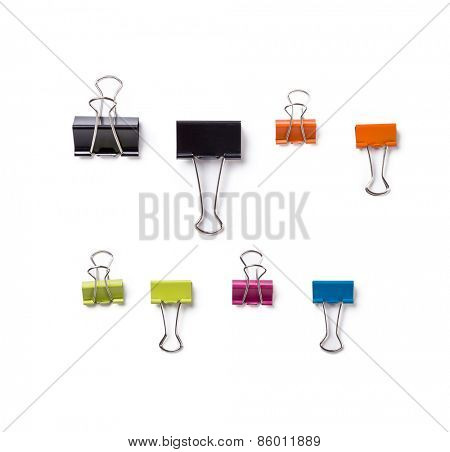 Multicolored paper clips in a pile on a white background.
