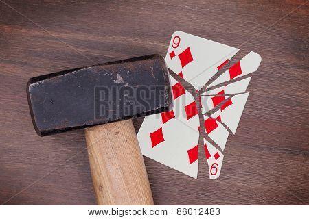 Hammer With A Broken Card, Nine Of Diamond