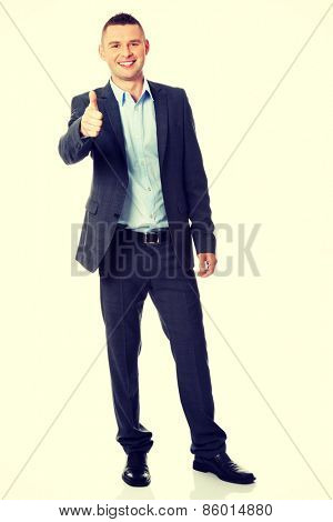 Portrait of a friendly businessman gesturing thumbs up