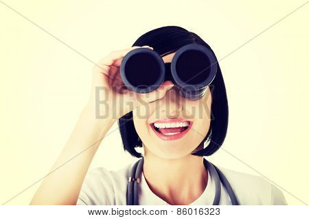 Looking in the futere of health care. Female doctor or nurse looking through binoculars.
