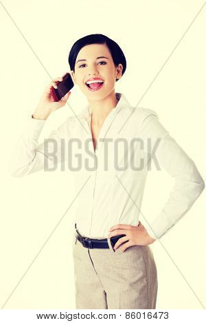 Young, confident, successful and beautiful businesswoman with the mobile phone.