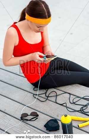 Sport woman using mobile phone