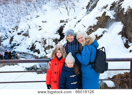 Beautiful family with kids outdoors on a winter day