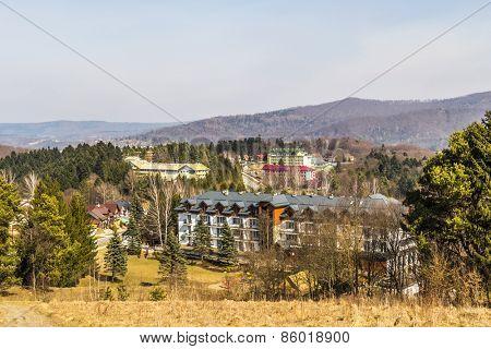 POLANCZYK ZDROJ, POLAND, MARCH 21, 2015: Sanatoriums in spa resort on the lakeside of Solina dam,  in Bieszczady mountains