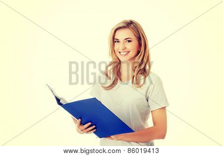 Portrait of a happy young student woman.