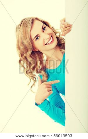 Portrait of young happy woman with blank board