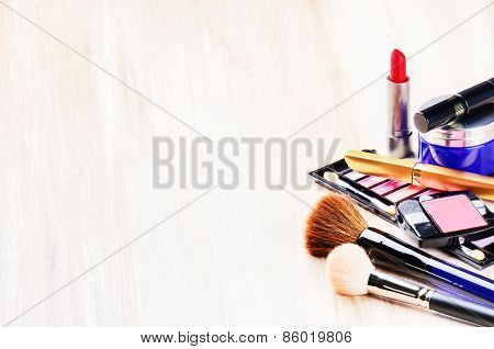 Various Makeup Products On Light Background