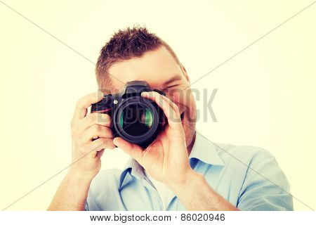 Man photographer at work with DSLR