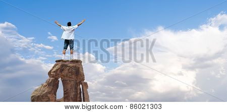 Winner Man Standing On The Top Of Mountain