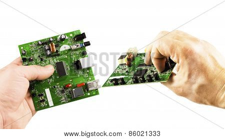 Electronic Microcircuit In The Hands Of Different Angles