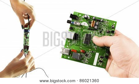 Various Electronic Microcircuits In Their Hands