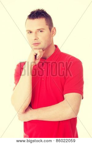 Handsome young thoughtful man wondering