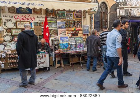 Turkish Bazaar View With Sellers And Walking Buyers