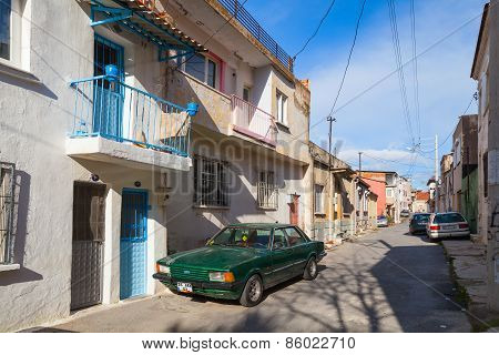 Ordinary street view with small living houses and parked cars