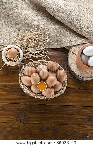 Vertical image of organic eggs in basket.