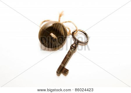 Old Key With Affection For Him A Button On A White Background