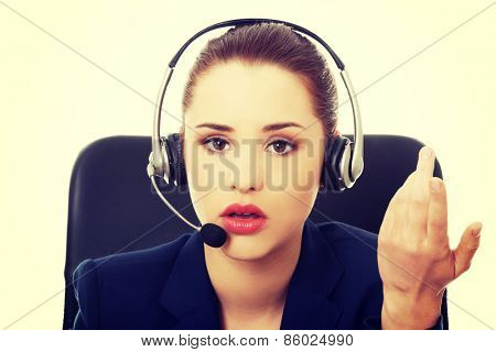 Portrait of anoyed support phone operator in headset