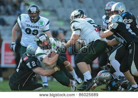 INNSBRUCK, AUSTRIA - MARCH 29, 2014: RB Dominik Kecskemeti (#1 Dragons) runs with the ball in an AFL football game.