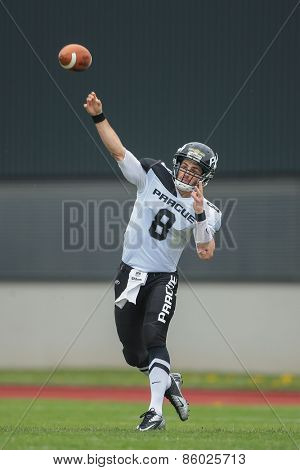 GRAZ, AUSTRIA - APRIL 04, 2014: QB Kyle Newhall (#8 Panthers) passes the ball in an AFL football game.