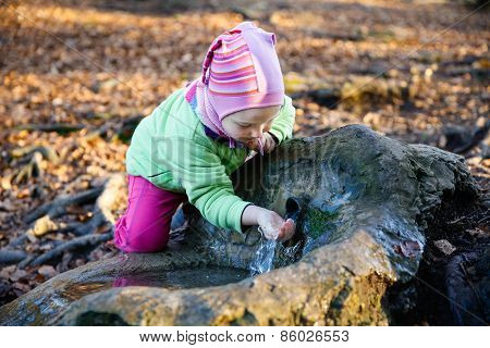 Thirsty Girl Drinking Spring Water