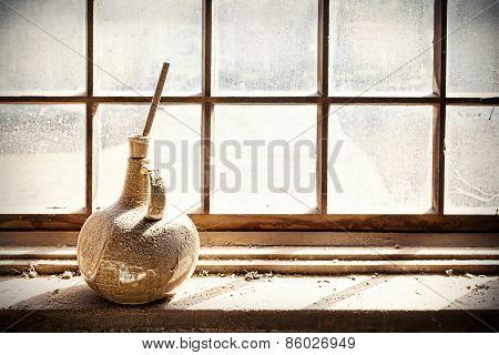 Old Vase On Grungy Window.