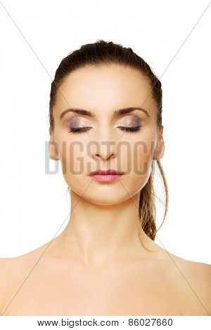 Beautiful caucasian woman with make up and eyes closed.