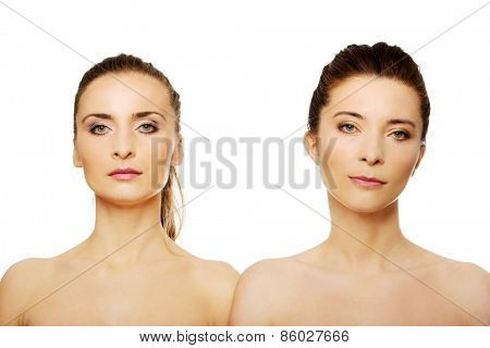 Two attractive topless sisters with make up.