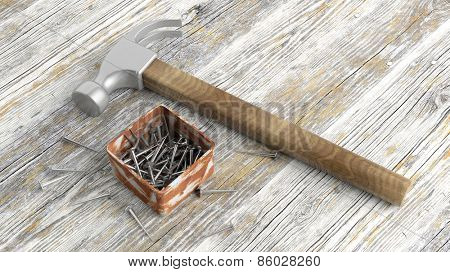 Hammer and box with nails on old wooden background
