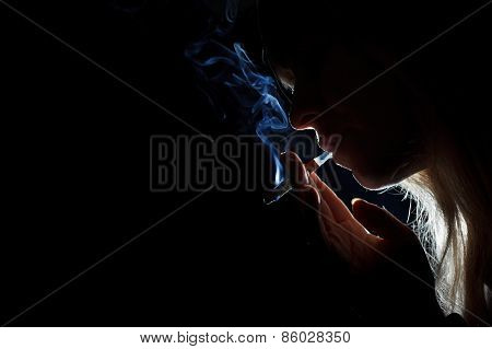 Silhouette of a cigarette smoker