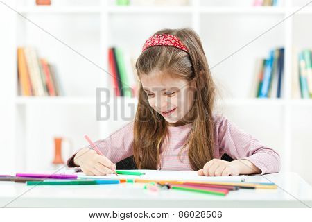 Happy child drawing