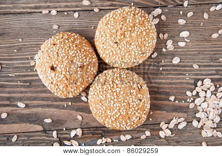 Three Cookies On A Wooden Background