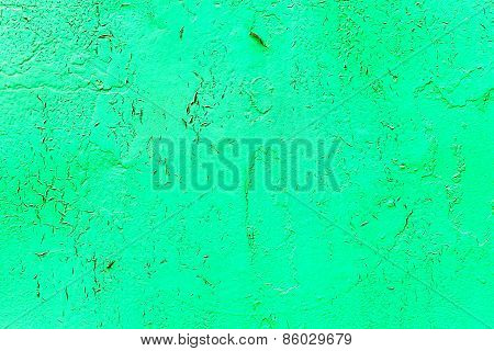 Vintage Old Damaged Wall With Cracks, Scratches, Painted With Green Paint. Textured Background For Y