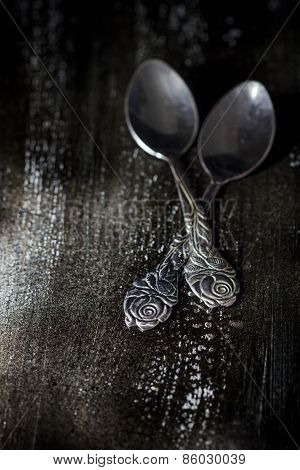 Two Spoons On Old Black Wooden