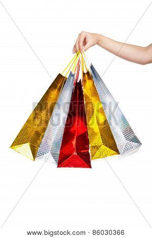 Womans hand holding colorful shopping bags