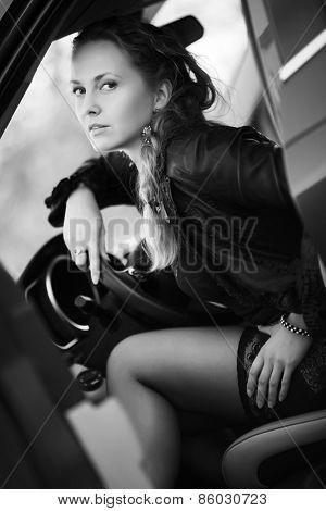 Beautiful fashion woman in a car