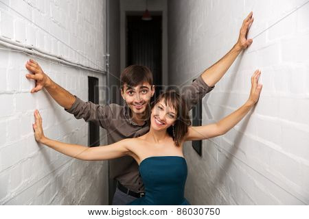 Happy young couple in office