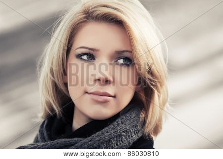 Portrait of happy blond fashion woman outdoor