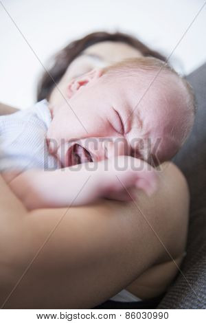 Newborn Crying On Mom Shoulder