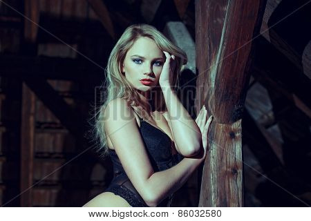 Sensual Woman Posing In The Dark At Timber