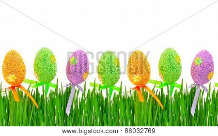 Fresh Green Grass And Colored Easter Eggs
