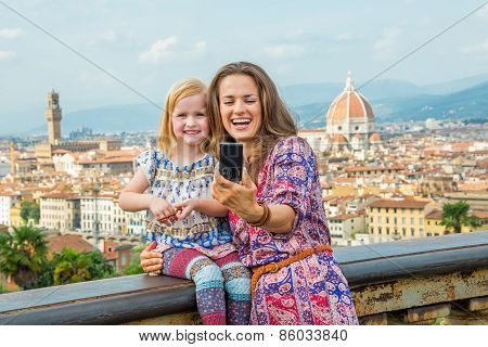 Happy Mother And Baby Girl Making Selfie Against Panoramic View