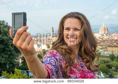Happy Young Woman Making Selfie In Front Of Panoramic View Of Fl