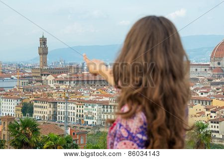 Young Woman Pointing On Panoramic View Of Florence, Italy. Rear