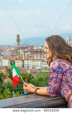 Happy Young Woman With Flag Against Panoramic View Of Florence,