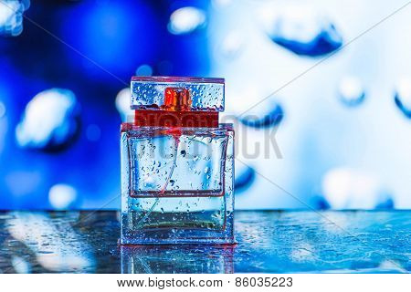 Square Perfume Bottle On Blue, White And Red Background