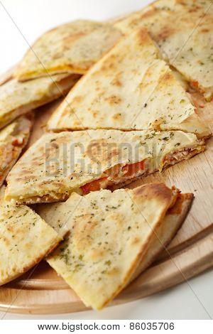 Italian Closed Pizza on Wooden Tray